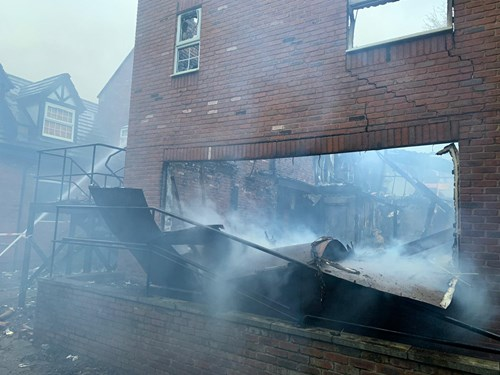 Smoke around the extinguished fire in derelict building